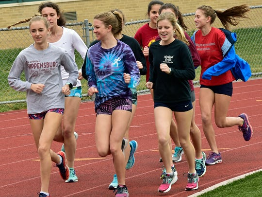 Chambersburg distance runners take a lap around the track during the first day of practice on Monday, March 6, 2017 at Trojan Stadium. This is the first week of spring practice for area teams.
