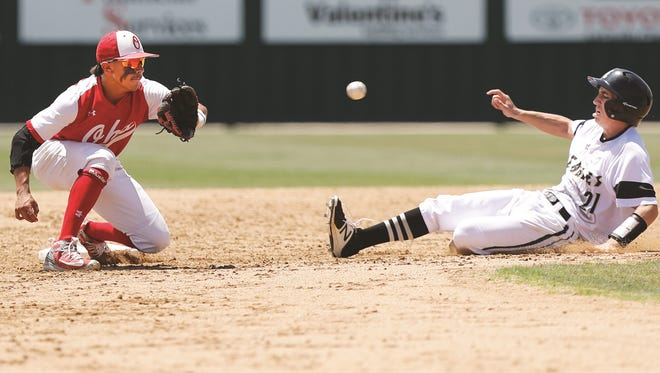 Abilene High's Reese Pettijohn (21) slides under the tag of Odessa High's Bo J. Martinez (8) in the 4th inning. Odessa High played Abilene High in the 6A area round of playoffs Saturday at Moegle Field in Lubbock. (Mark Rogers/Odessa America)