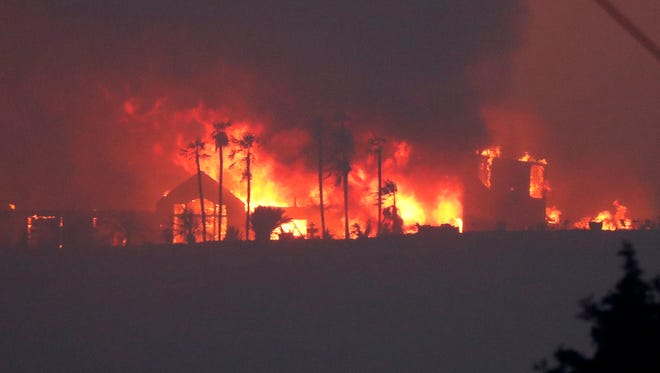 A luxury home taken over in flames from the River Fire in Lakeport, California on July 31. The River and Ranch fire have combined as the Mendocino Complex Fire.