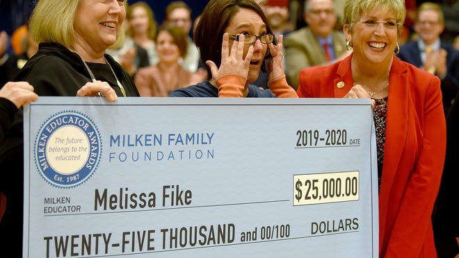 Missouri First Lady Teresa Parson, left, and Angie Besendorfer, chancellor of Western Governors University-Missouri, present a $25,000  Milken Educator Award in January to Oakland Middle School teacher Melissa Fike, center. Teressa Parson has tested positive for COVID-19, the governor's office confirmed Wednesday.