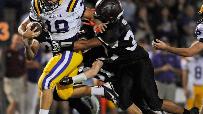 Tallassee's Brandon Baynes (18) carries the ball against Alabama Christian's Joshua Felix (32) at the ACA campus in Montgomery, Ala. on Friday October 11, 2013.(Mickey Welsh, Montgomery Advertiser)