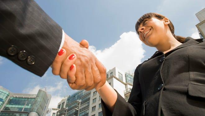 Businesswoman shaking hands.