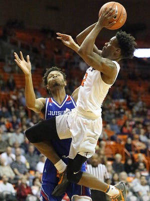 UTEP guard Omega Harris soars to the basket in a shot attempt against Louisiana Tech's Jy'lan Washington on Thursday in the Don Haskins Center.