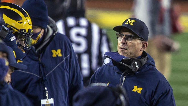 Michigan head coach Jim Harbaugh on the sidelines in the first quarter of an NCAA college football game against Wisconsin in Ann Arbor, Mich., Saturday, Nov. 14, 2020.
