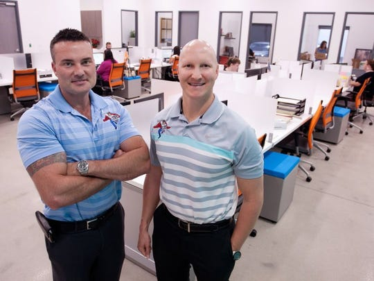 Owners Keegan Hodges, left, and his brother Chadd Hodges at the new Best Home Services location in Naples, FL on Monday, February 29, 2016. (Photo by Gregg Pachkowski/Special to the Daily News)