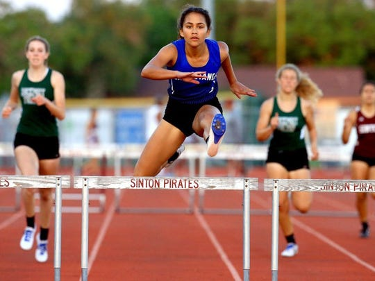 Ingleside's Jordan Blanton jumps the last hurdle to win the girls 300-meter hurdles during the District 31-4A track meet running finals Thursday, April 14, 2016, at Pirate Stadium in Sinton.