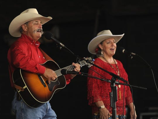 Cowboy poets and singers Gary (left) and Jean Prescott perform during the Western Heritage Classic in 2015 at the Taylor Expo Center.