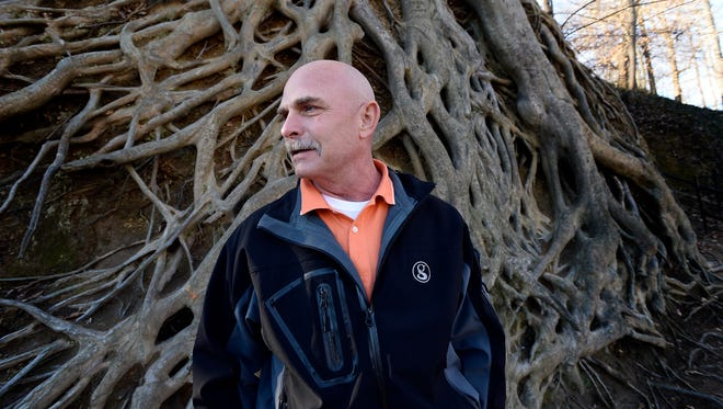 Horticulturalist Dale Westermeier, a 29-year employee of the City of Greenville, remains in awe of the iconic American Beech tree at Falls Park in Greenville, S.C.