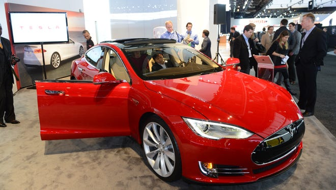 The Tesla Model S is introduced at the 2013 North American International Auto Show in Detroit.