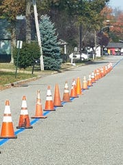 A blue line was painted down Baker Street in Mine Hill to honor police and other first responders.