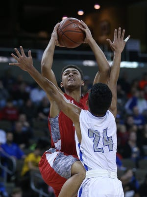Dixie's Hunter Meyer takes the ball to the basket over Scott's Vincent Dumlao.