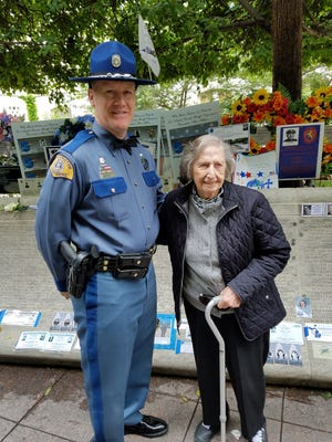 Marcelle Gorman, 96, of Green Brook attended the May 11-17 Police Week in Washington to honor her father, Vernon G. Fortin, who was killed in the line of duty in 1923 in Washington. She met with Washington State Highway Patrol Trooper Michael  Cheek at the National Law Enforcement Officers Memorial Wall.