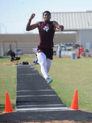 Brownwood's Adonis McCarty competes in the long jump finals during the District 5-4A meet at Wylie on Thursday, April 5, 2018. McCarty won with a jump of 22-10 to go with his triple jump title on Monday.