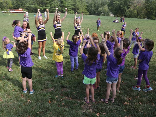 Indianola High School cheerleaders lead a cheer during