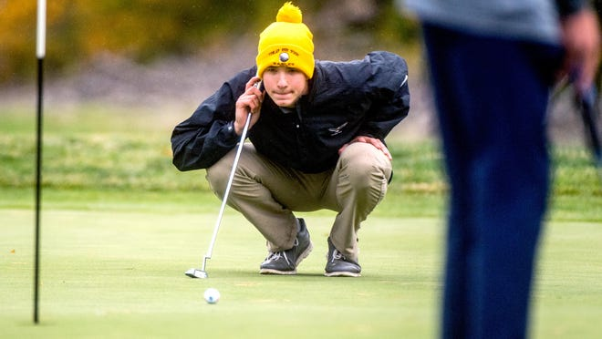 Dunlap's Eli Lanser line up his shot on No. 2 during the Class 2A Richwoods Sectional golf championship Monday, Oct. 12, 2020 at Kellogg Golf Course in Peoria.