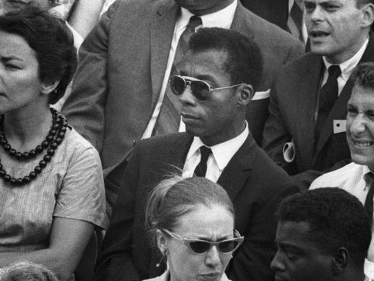 "James Baldwin (center) is the focus of ""I Am Not Your"