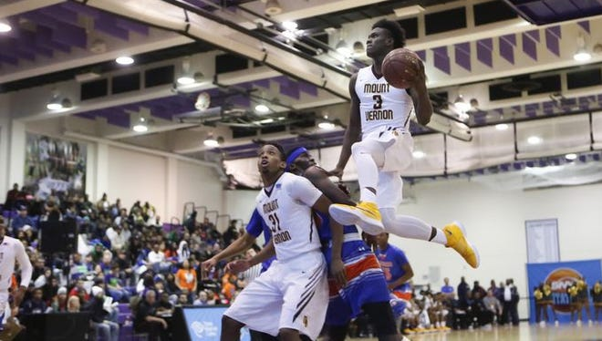 Mount Vernon's Derrick Hamlin (3) drives to the basket against Cardozo in the SNY Invitational NYC High School Basketball Showdown at the City College of New York on Friday, Jan. 29, 2016.