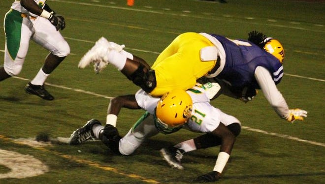 Green Oaks safety Damien Crawford makes a tackle against Byrd last season.