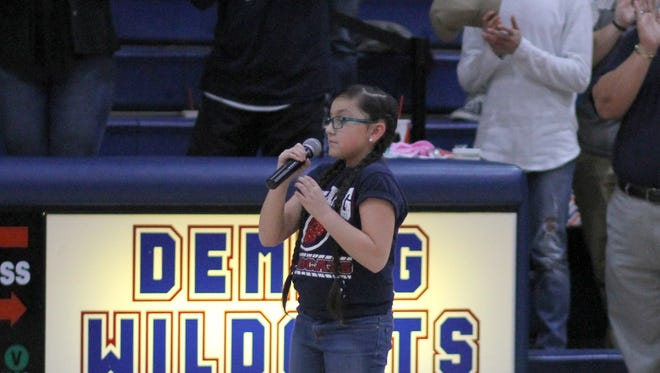 Micah Martinez, a fifth grader at Ruben S. Torres Elementary School, gave a rousing rendition of the Star-Spangled Banner on Friday prior to the Alamogordo-Deming boys' basketball game at Deming High School. Martinez, 10, also performed at the state capitol last week for the New Mexico Legislature in Santa Fe. Alamogordo won the game (see Paqe 1B for story and photo).