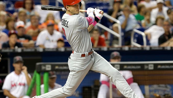 Philadelphia Phillies' Tyler Goeddel follows through on his game-tying RBI double against the Miami Marlins in the eighth inning Sunday. Emmanuel Burriss scored on the double. The Phillies won, 6-5.