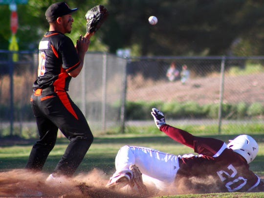 Andres Aragon, right, slides into third base to beat the throw to Lordsburg's Jacob Esquivel.