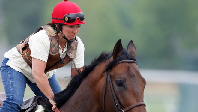 Preakness entrant First Dude ridden by Tammy Fox ride during morning workouts at Pimlico Race Course, Friday, May 14, 2010, in Baltimore. The 135th Preakness horse race is held Saturday, May 15th.(AP Photo/Mel Evans)