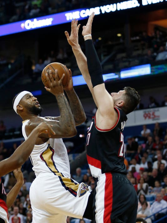 New Orleans Pelicans forward DeMarcus Cousins (0) goes to the basket against Portland Trail Blazers center Jusuf Nurkic (27) in the first half of an NBA basketball game in New Orleans, Tuesday, March 14, 2017. (AP Photo/Gerald Herbert)