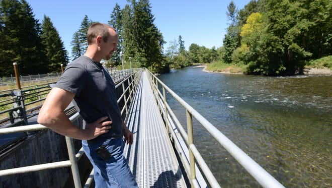 Tim Sherman, operations and maintenance supervisor at the Geren Island Water Treatment Facility in Stayton, shows the middle intake area, which is the first filtration step. Photographed on Thursday, Aug. 7, 2014.