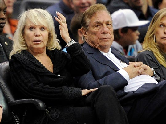 FILE - In this Nov. 12, 2010, file photo, Los Angeles Clippers owner Donald T. Sterling, right, sits with his wife Rochelle during the Clippers NBA basketball game against the Detroit Pistons in Los Angeles. An attorney representing the estranged wife of Clippers owner Donald Sterling said Thursday, May 8, 2014, that she will fight to retain her 50 percent ownership stake in the team.  (AP Photo/Mark J. Terrill, File)