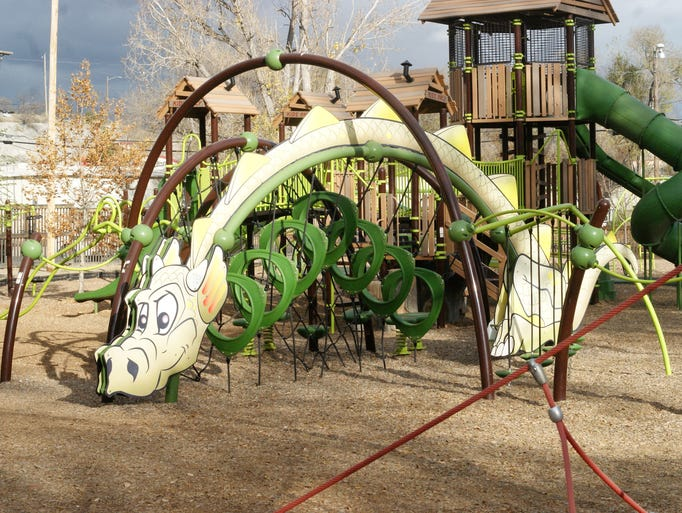 "This dragon attracts visitors to an ""Evos"" play structure"