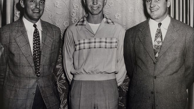 A photo of Bart Starr standing with Lanier High School coach Bill Moseley, left, after committing to the University of Alabama.