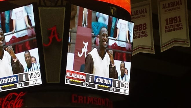 New WBC heavyweight champion Deontay Wilder flashes his smile on the jumbotron at Coleman Coliseum in his hometown of Tuscaloosa during the first half of the Auburn-Alabama game.