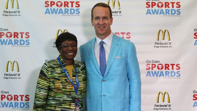 Peyton Manning poses for photos with Shreveport Mayor Ollie Tyler before Monday's Times Sports Awards.