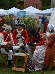 1st Battalion New Jersey reenactors relax at their