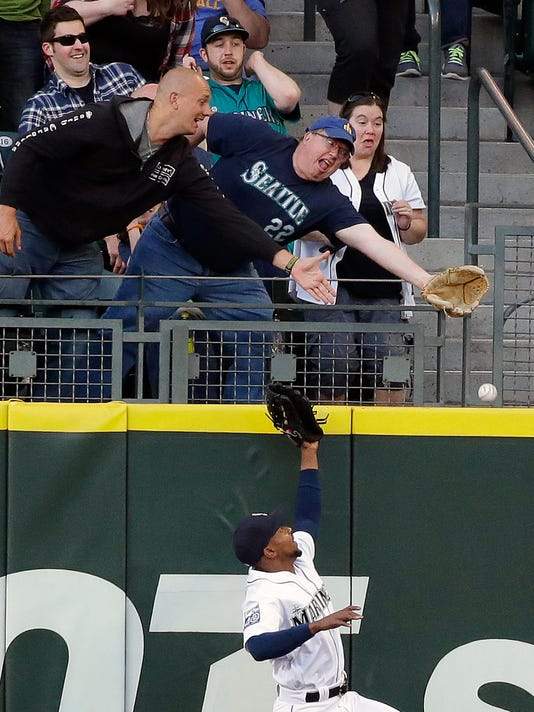 Seattle Mariners center fielder Jarrod Dyson leaps for but cannot catch a solo home run hit by Chicago White Sox's Avisail Garcia in the third inning of a baseball game, Saturday, May 20, 2017, in Seattle. (AP Photo/Ted S. Warren)