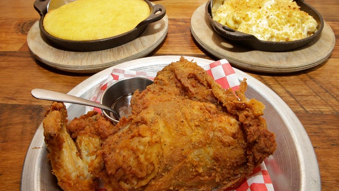 Fried chicken and side dishes at The Eagle restaurant in Cincinnati.