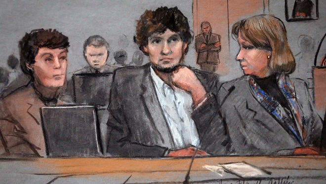 In this courtroom sketch, Dzhokhar Tsarnaev, center, is depicted between defense attorneys Miriam Conrad, left, and Judy Clarke, right, during his federal death penalty trial, Thursday, March 5, 2015, in Boston. Tsarnaev is charged with conspiring with his brother to place two bombs near the Boston Marathon finish line in April 2013, killing three and injuring 260 people.