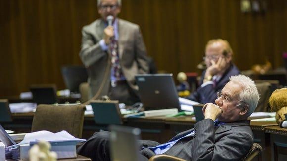 0502120639mp PNI0502-met politics budget vote - 01 MAY 2012 - PHOENIX, AZ:  State Rep. John Kavanagh (CQ) at his seat during the votes on the state budget at the State Capitol Tuesday.   Photo by Jack Kurtz/The Arizona Republic