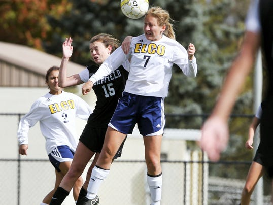 Elco's Eve Peiffer heads the ball as Hempfield's Cameron Hukill contests the play.