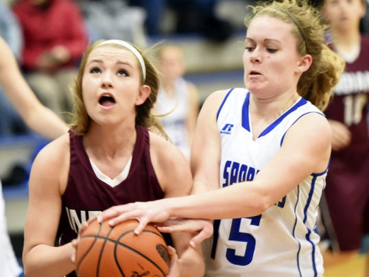 Southern Fulton's Celina Merchant, left, is defended by Bridgette Ritchey, of McConnellsburg, on Friday night. The Indians defeated the Spartans, 54-38, in the opening round of the District 5 Class A playoffs.