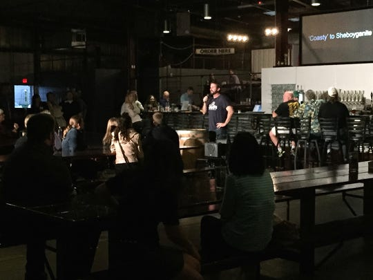 A community gathers at the 3 Sheeps Taproom to listen
