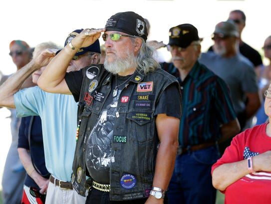 Citizens honor America during the National Anthem on