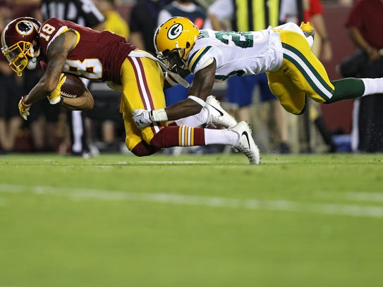 Washington receiver Josh Doctson is tackled by Green