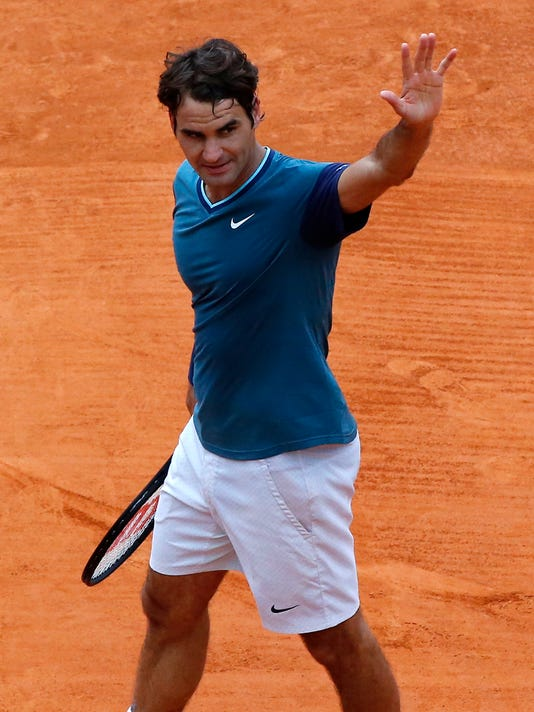 Federer alludes to Rome return after boys' birth