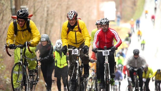 Cyclists climb the steep hill of Arrow Point Drive during the 2017 Chilly Hilly, an island event that draws thousands of riders from around Puget Sound each February.