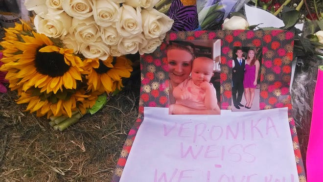 Flowers, photos and a note adorn a sidewalk memorial for Veronica Weiss, who along with Katie Cooper were two of the victims of a shooting rampage by Elliott Rodger, outside a the Delta Phi sorority house, in the Isla Vista neighborhood of Goleta, Calif., Monday, May 26, 2014. Six people, all students at nearby University of California, Santa Barbara, were killed before Rodger was killed by gunfire in the 10-minute rampage Friday, May 23. (AP Photo/Christopher Weber)