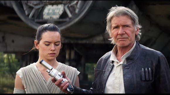 Daisy Ridley (as Rey) and Harrison Ford (as Han Solo)