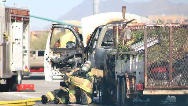 Phoenix fire crews put out a blaze in a vehicle on 56th Street near Loop 101 in northeast Phoenix shortly before noon on Thursday, Dec. 8, 2016.