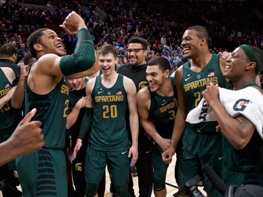 Miles Bridges, left, celebrate MSU's 63-45 win over