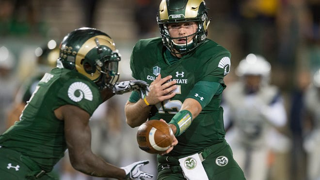 CSU running back Dalyn Dawkins takes a handoff from quarterback Collin Hill during an Oct. 8, 2016, game against Utah State at Hughes Stadium. Athletic director Joe Parker said CSU has sold a record 13,600 season tickets for the 2017 season with the opening game still two months away.